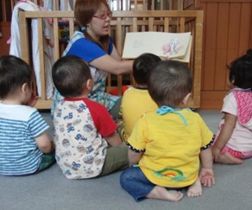 Why does Japan still use 'orphanages' rather than family-based foster care and adoption?